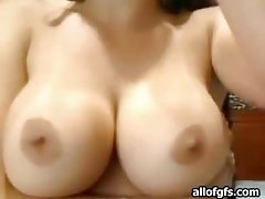 Diamond Kitty rubs her big tits on webcam tubes