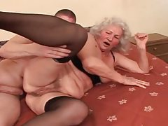 Naughty granny in sexy lingerie enjoying younger cock tubes