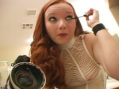 Hot redhead puts on her makeup tubes