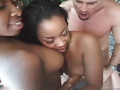 Horny ebony duo with pierced pussies in interracial threesome tubes