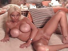 Amateur chick has huge fake tits tubes