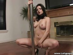 Curvy girl dances on the pole tubes