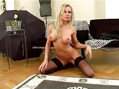 Glamour babe fingering her shaved pussy in nylons tubes