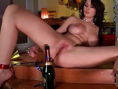 Champagne bottle in her shaved pussy tubes