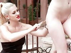 Bound redhead beaten by mistress in lipstick tubes