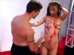 Painting the hot body of an Asian and eating her pussy tubes