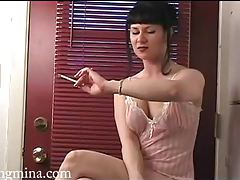 Lingerie girl in sexy dark lipstick smokes tubes