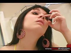 Ditsy brunette cutie Candi putting on her makeup tubes