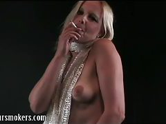 Blonde milf having a smoke whilst her tits are hanging out tubes