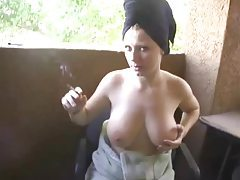 Ami lets her big juicy jugs out as she smokes outdoors tubes