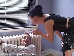 Seductive dominatrix enjoys a smoke whilst teasing her sex slave tubes
