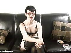 Pale short haired goth babe with glasses having a smoke tubes