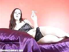 Brunette with milky white skin having smoke in her lingerine tubes