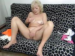 Granny strips nude and plays with her pussy tubes