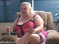 Big busty blonde BBW having a smoke on her couch tubes