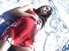 Pregnant babe Embrianna having a smoke on the beach tubes