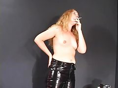 Perky titted blonde in leather pants enjoying a smoke tubes