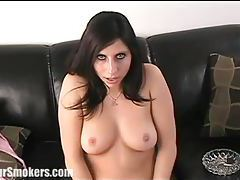 Sultry raven haired babe in sexy black lingerie smoking tubes