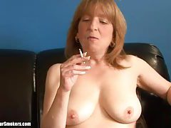 Mature blonde lady getting naked as she enjoys a smoke tubes