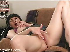 Masturbating babe in short skirt smoking tubes
