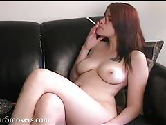 Teen redhead with pierced lips having a smoke topless tubes