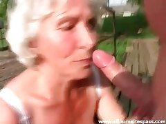 Granny sucks him off outdoors tubes