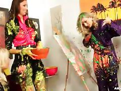Clothed women make a mess with paint tubes