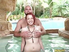 Busty redheaded beauty in the hot tub tubes