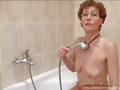 Mature strips from cardigan and shaves pussy tubes