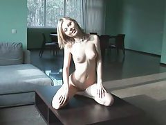 Adorable blonde displays her shaved pussy tubes