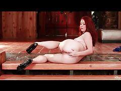 Redhead Melody Jordan masturbates solo tubes