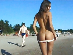 Naked teen riding a horse at the beach turns heads tubes