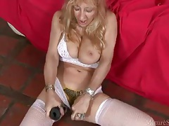 Temptress in white lingerie masturbates her pussy tubes