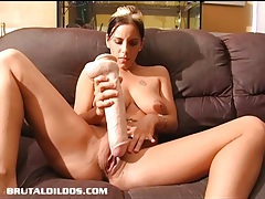 Pamela filling her once tight pussy with a massive dildo tubes