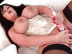 Chubby girl in tight corset masturbates pussy tubes