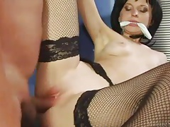 Wicked sexy brunette in fishnets laid tubes
