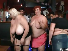 Fat women share their huge tits in the bar tubes