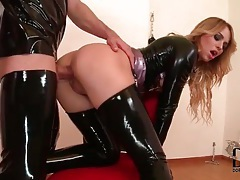 Slut in tight latex fucked in the butt tubes