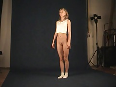 Teen dancer shows her skinny body in photo studio tubes