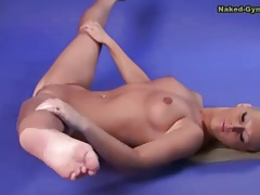 Flexible young beauty with long blonde hair tubes