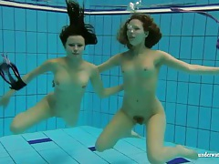 Both ladies in bikinis are hot stuff underwater tubes