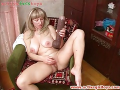 Old lady has solo sex with a huge toy tubes