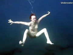 Redheaded girl is so sexy naked in the water tubes