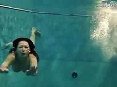 Underwater with bikini swimming girls tubes