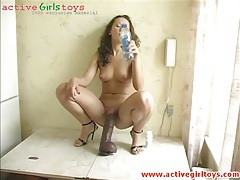 Beauty perched atop a monster dildo to ride tubes