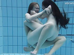 Cute girls fool around naked in the pool tubes