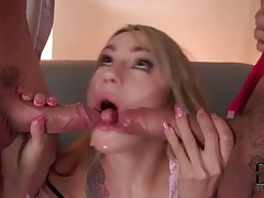 She sucks and slobbers on a pair of cocks tubes