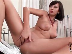 Glamorous big tits girl fingers her hot box tubes