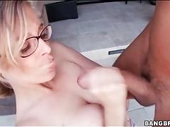 Blue eyed girl in glasses sucks big cock tubes