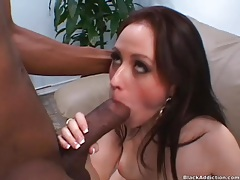 Young Cindy Jennings bounces on black cock tubes
